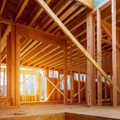 photo of building under construction showing wood beams and frames